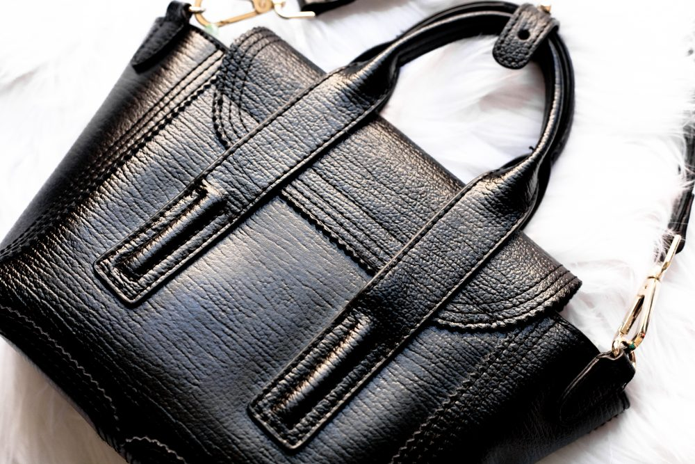 Phillip Lim's Pashli Mini is a whopping $695. Here is a dupe I found for only $59.86! Read the full review and find out where to buy here. - www.theballeronabudget.com