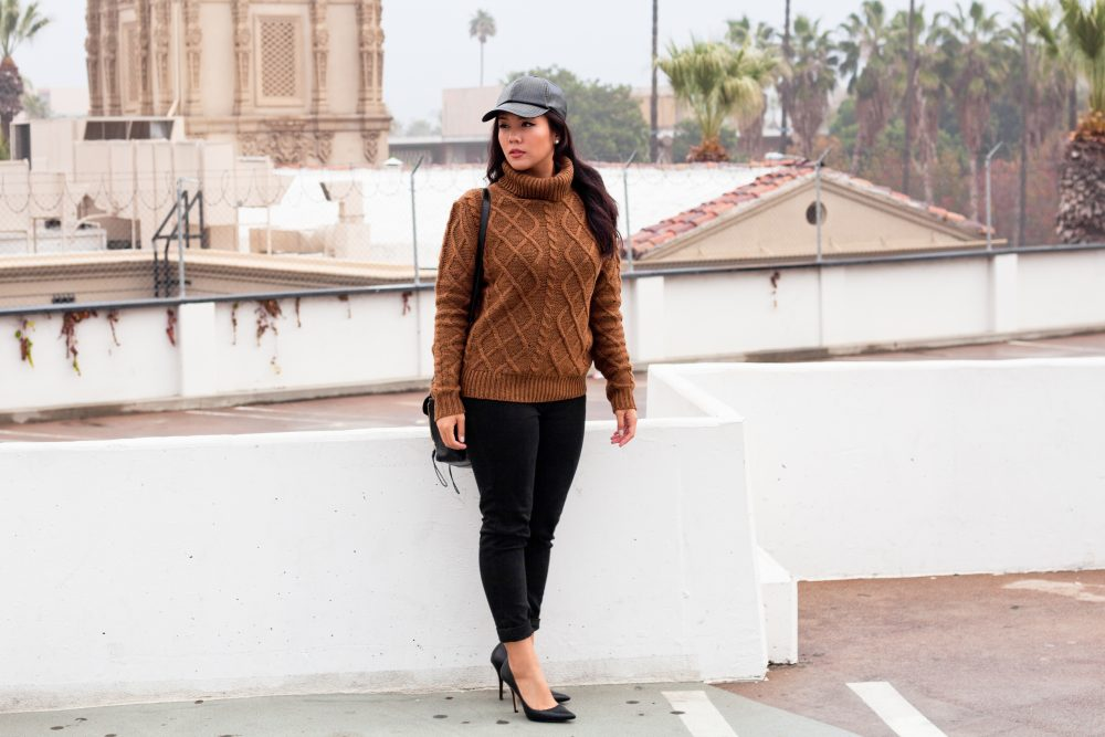 Get the Look (from top to bottom): Baseball Hat: $4.99 at Ross, Turtleneck: $19.95 at Cotton On, Levi's 711 Skinny Jeans: $24.99 at Levi's, Leather Purse: $59.86 on AliExpress, Aldo Haollan Dress Pump: $35.47 on Amazon, Wrap Bracelet: $44.50 on Etsy