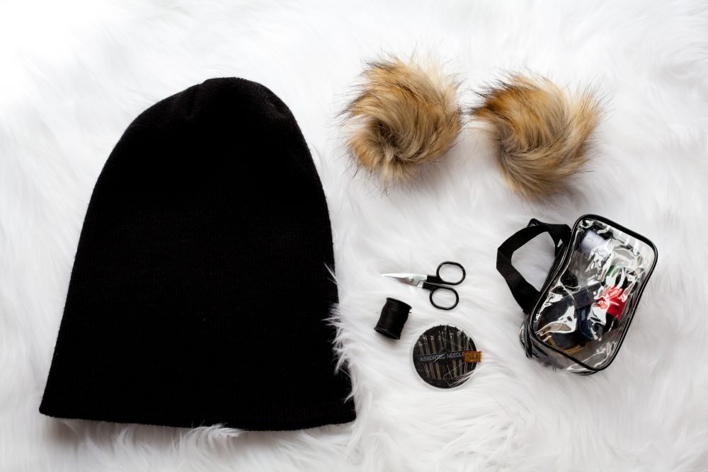These cute furry-eared pom-pom beanies are the trend of the season! You can make them by yourself for almost less than $10. It's a quick and easy DIY project even I can do! - THE BALLER ON A BUDGET