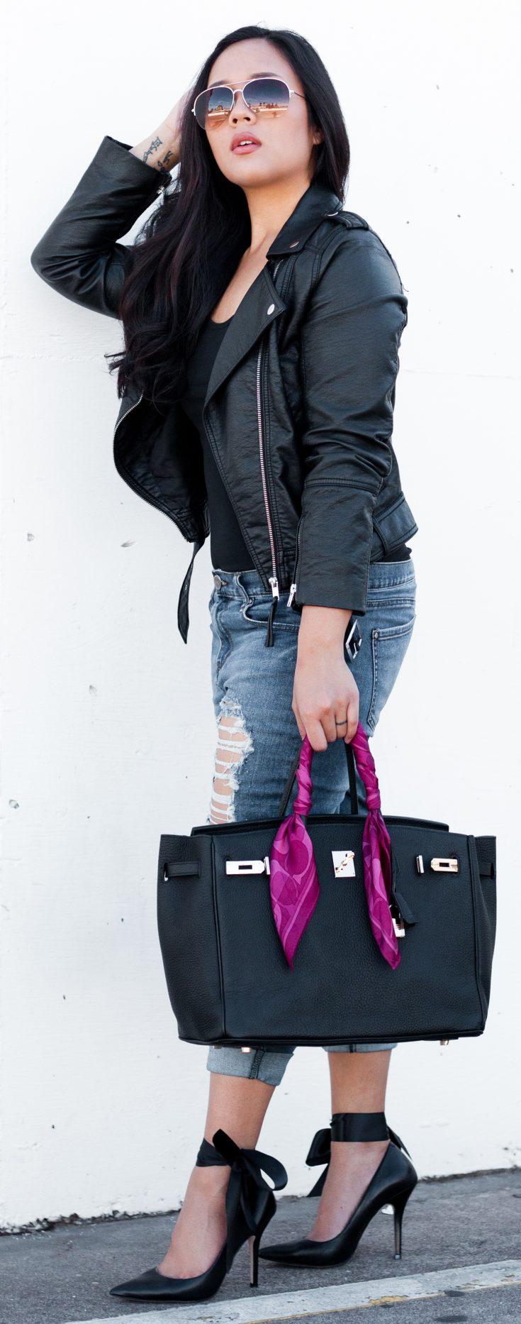 Shop the look: Sunglasses: $6.99, Biker Jacket: $39.99, Longsleeve Top: $16.99, Distressed Jeans: $29.90, Heels: $63.16, Leather Handbag: $64.83 - www.theballeronabudget.com