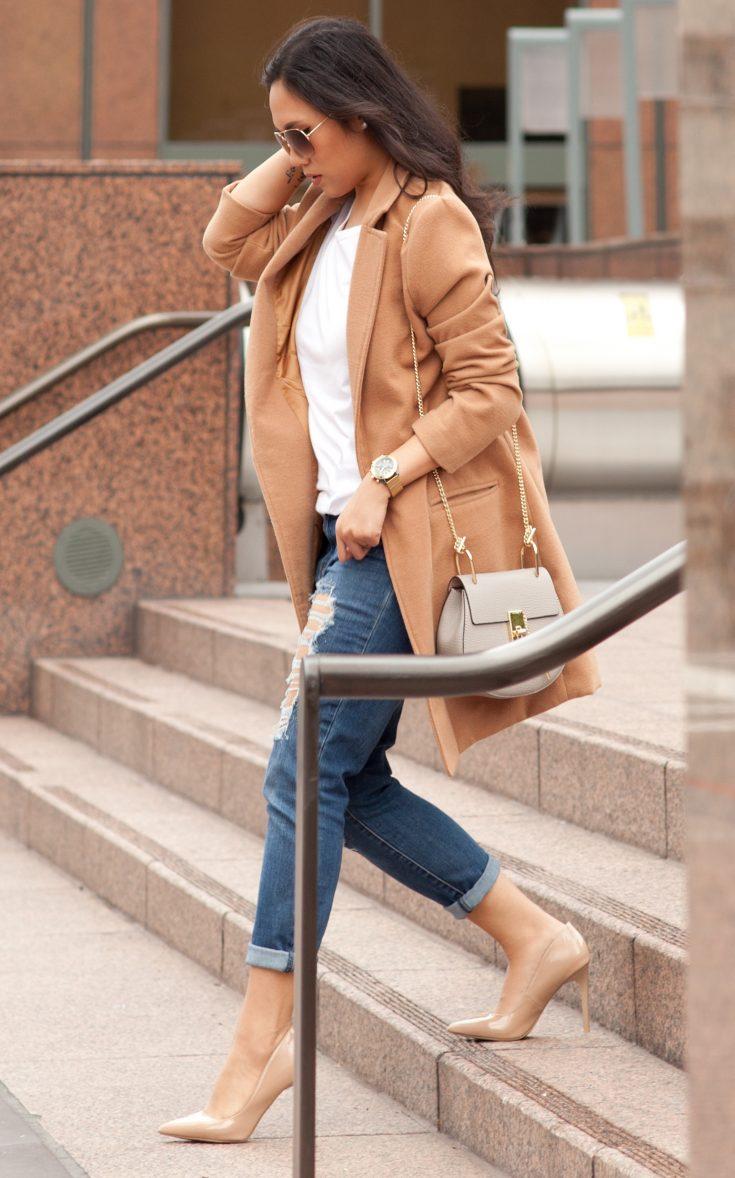 Shop the look: Coat: $27, Jeans: $34.99, T-shirt: $3.00, Shoes: $19.99, Sunglasses: $6.99, Purse: $39.99. - www.theballeronabudget.com