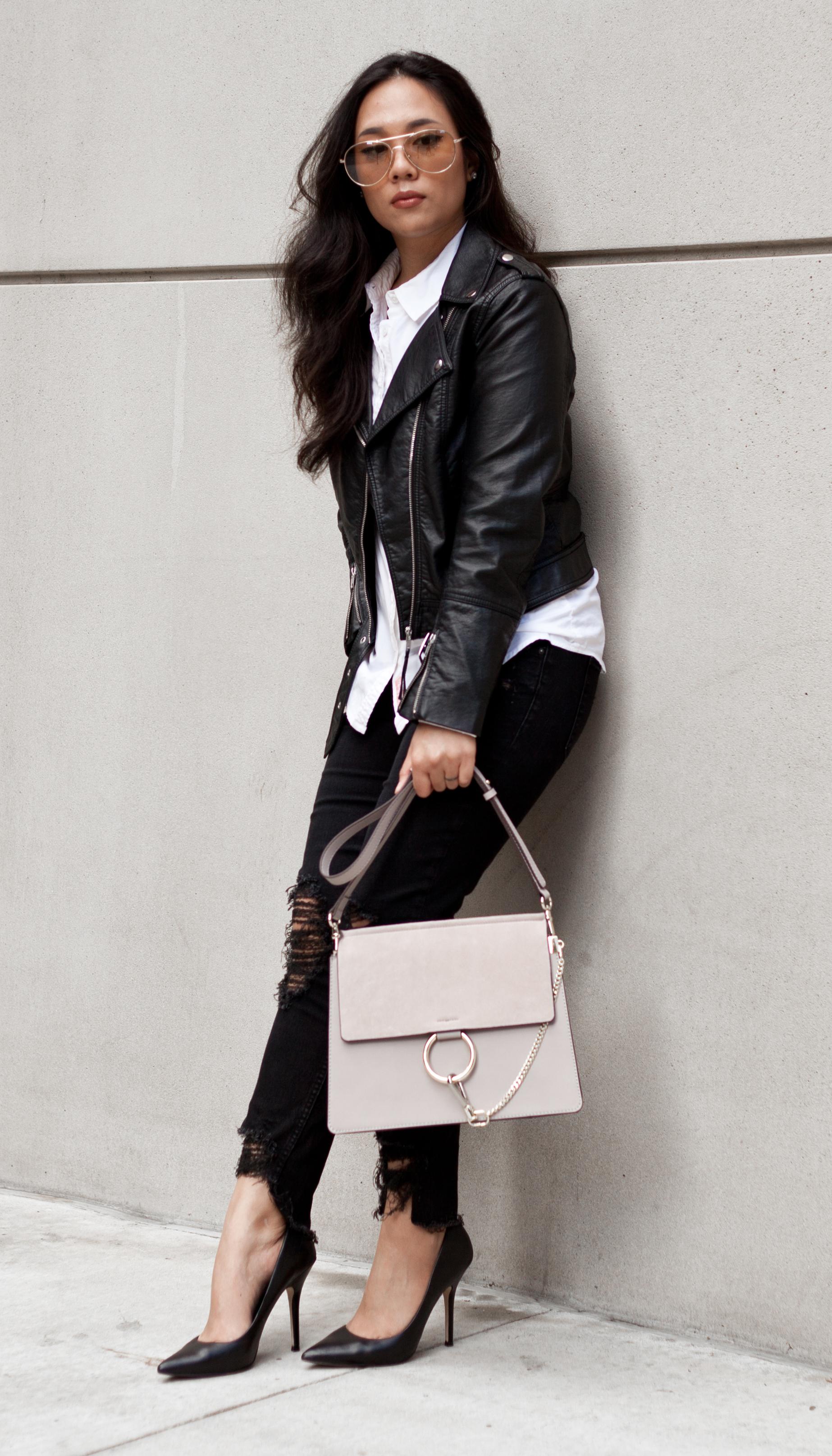 Shop the look- Sunglasses: $9.99, Genuine Leather Handbag: $65.08 (Dupe for Chloe's $1,950 Faye), Biker Jacket: $29.99, Shirt: $19.90, Jeans: $29.90, Heels: $37.00 - www.theballeronabudget.com