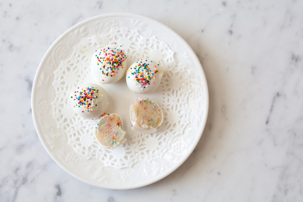 Want something less chocolatey and more vanilla-y? These $10 Funfetti cake truffles are easy to make and look so cute packaged in a box with a bow. Click here for the recipe. - www.theballeronabudget.com