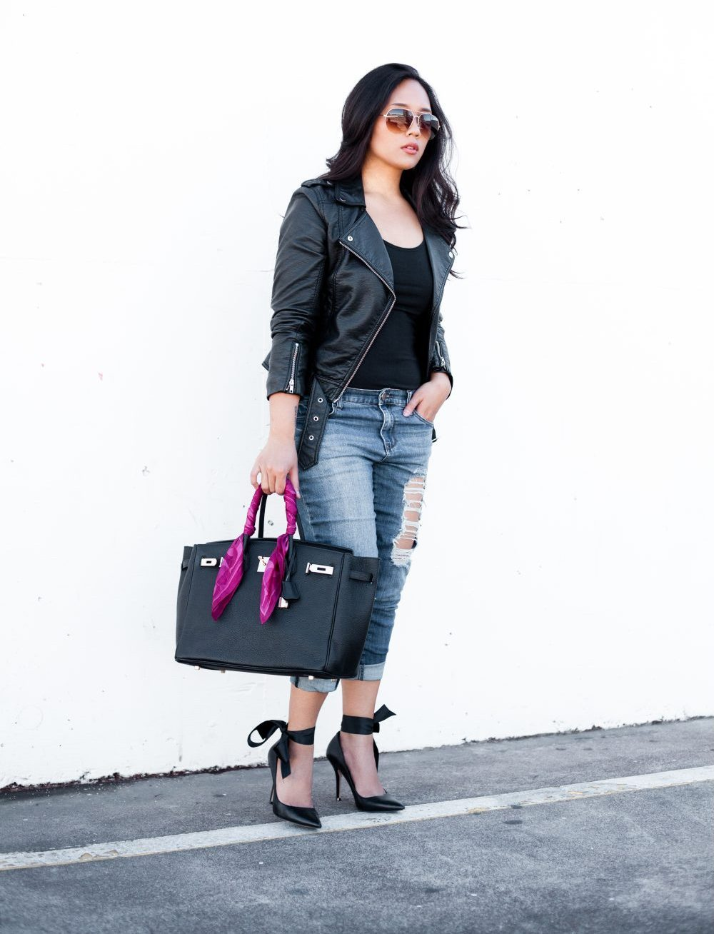 Shop the look: Sunglasses: $6.99, Biker Jacket: $39.99, Longsleeve Top: $16.99, Distressed Jeans: $29.90, Heels: $63.16, Leather Handbag: $64.83 - www.theballeronabudget.com