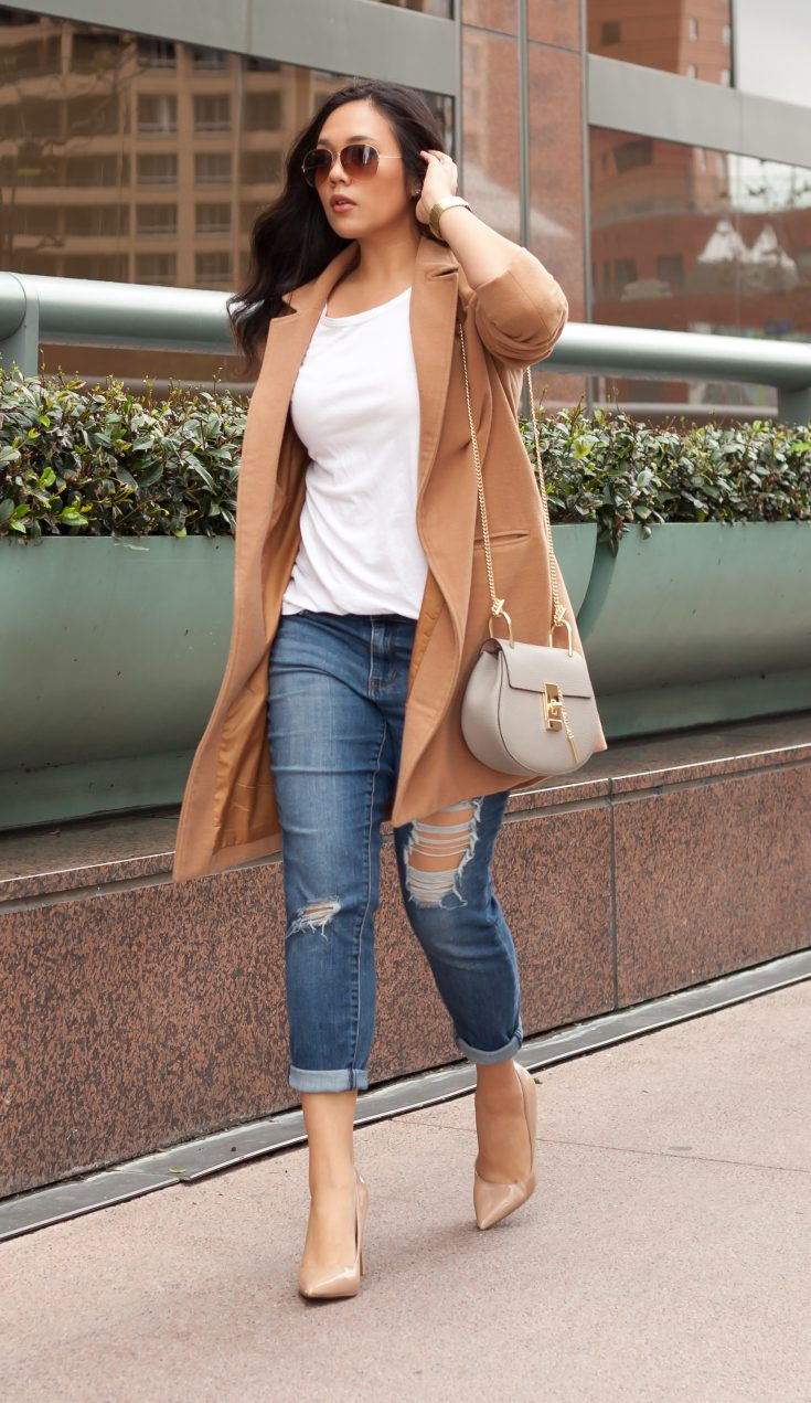 Shop the look: Coat: $27, Jeans: $34.99, T-shirt: $3.00, Shoes: $19.99, Sunglasses: $6.99, Purse: $39.99. - www.theballeronabudget.com
