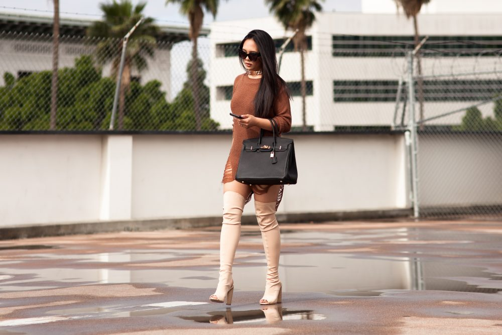 Shop the look- Sweater: $17.50, Boots: $32.50, Handbag: $74, Gold Chain Choker: $10.99, Sunglasses: $6.99 - www.theballeronabudget.com