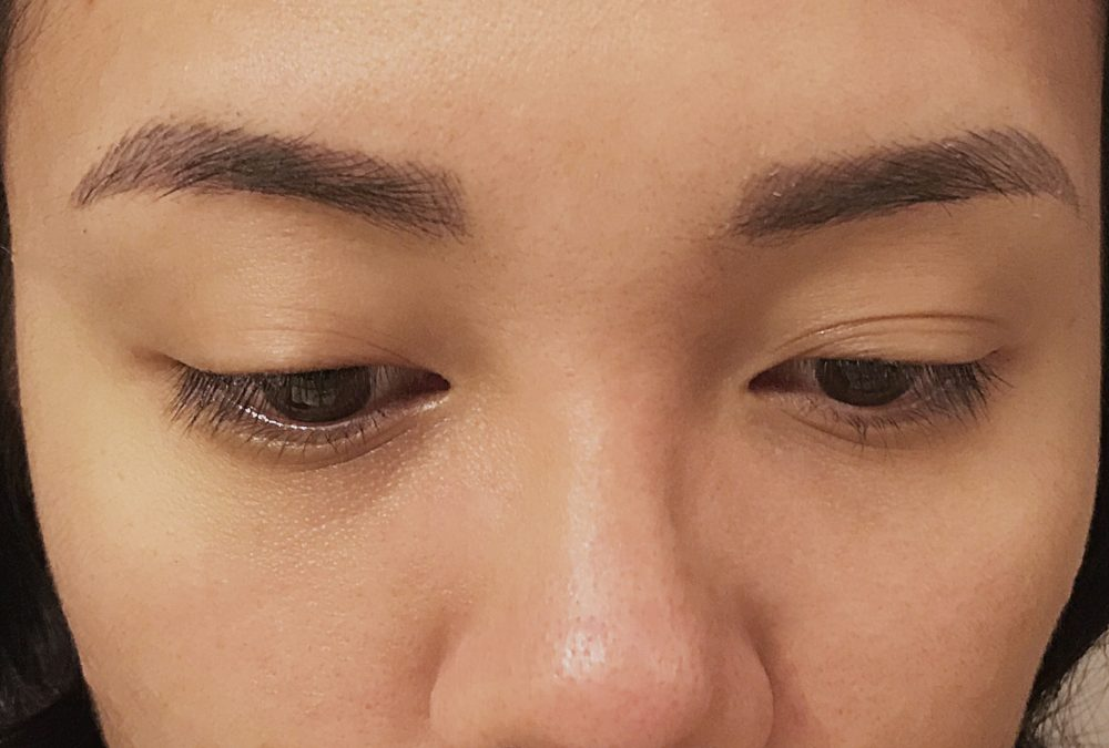 Week 4 post-microblading procedure. The color has lifted significantly and looks much less dark. The color now matches my natural hair color.
