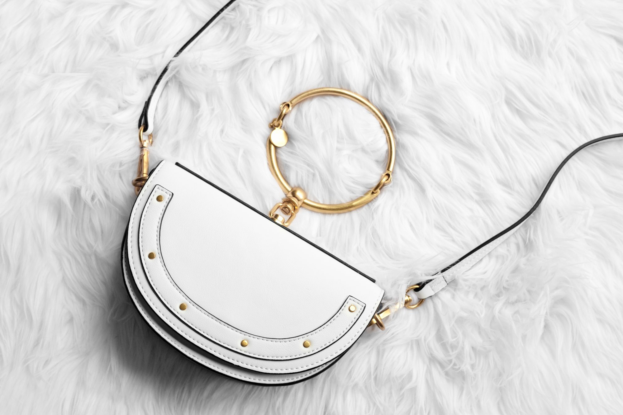 The ever-popular small Nile Minaudiere handbag by Chloe is priced at $1,450. I've found this gorgeous genuine leather designer dupe for just $44.63! Find out where to buy here. - www.theballeronabudget.com