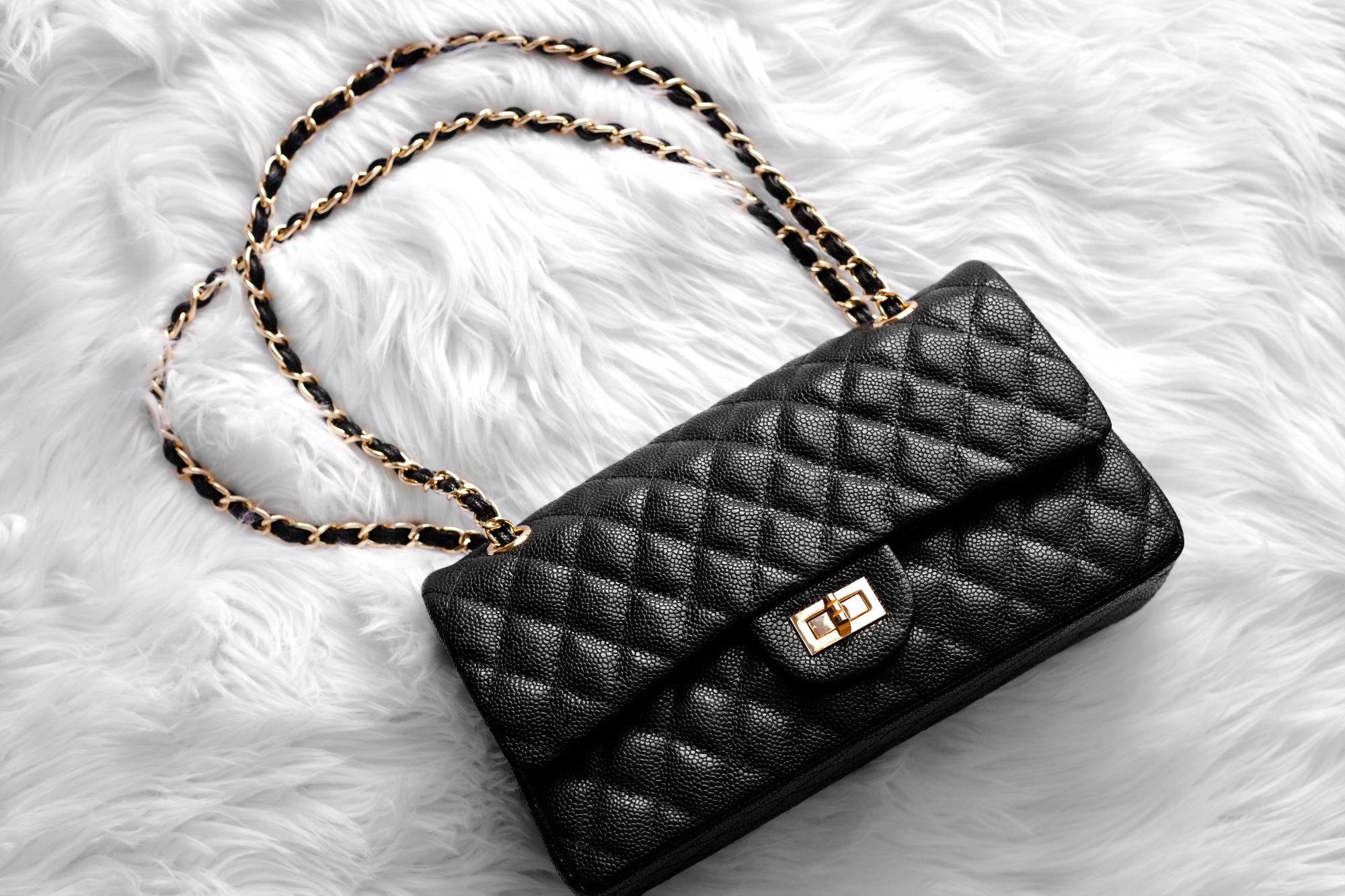 5b7f650355b5 Looking for a Chanel handbag without the hefty price tag  This genuine  leather one from ...