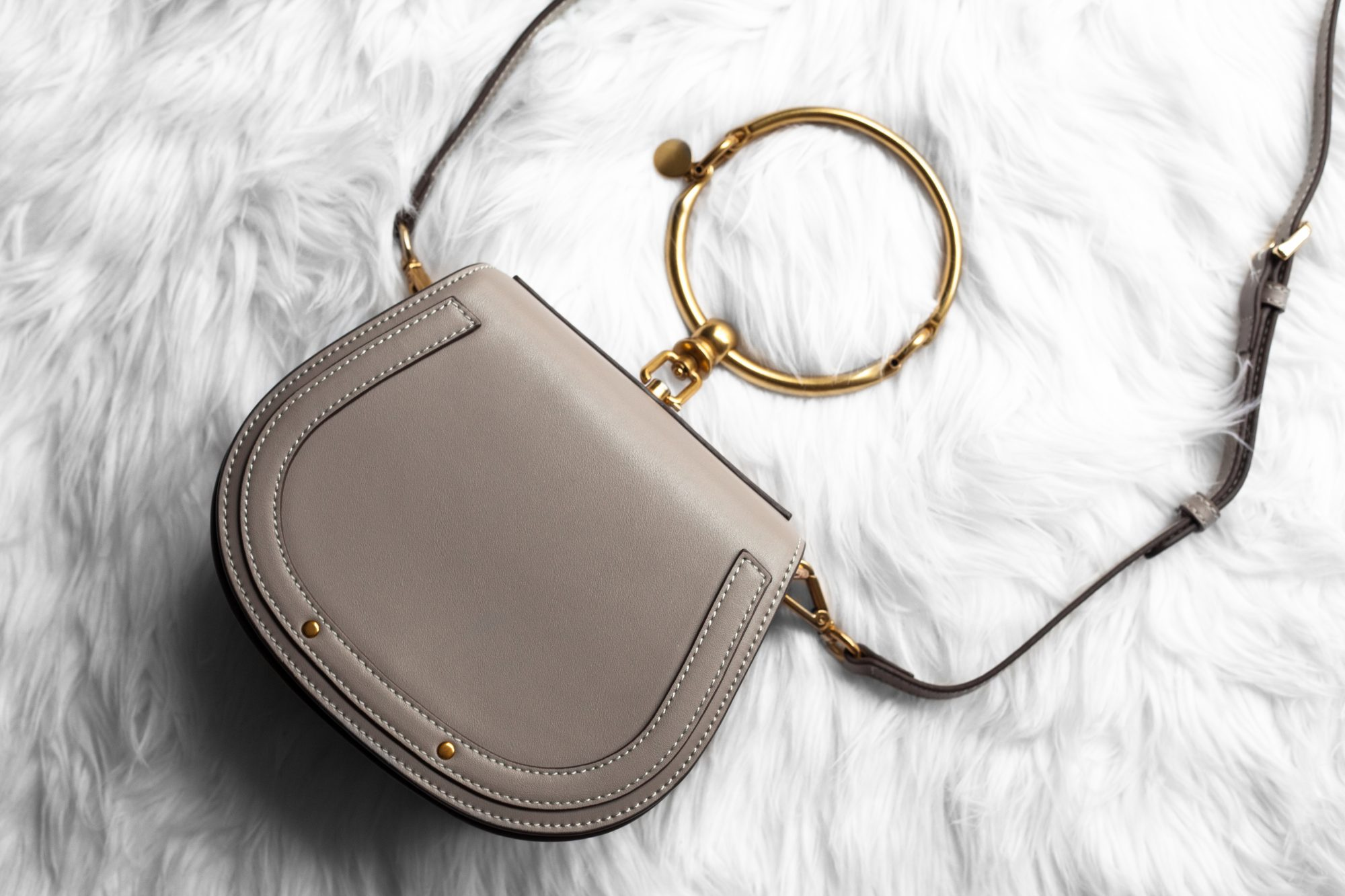 Chloe's popular small Nile bracelet handbag is priced at a hefty $1,550. I've found this gorgeous genuine leather designer dupe for just $40.43! Find out where to buy here. - www.theballeronabudget.com