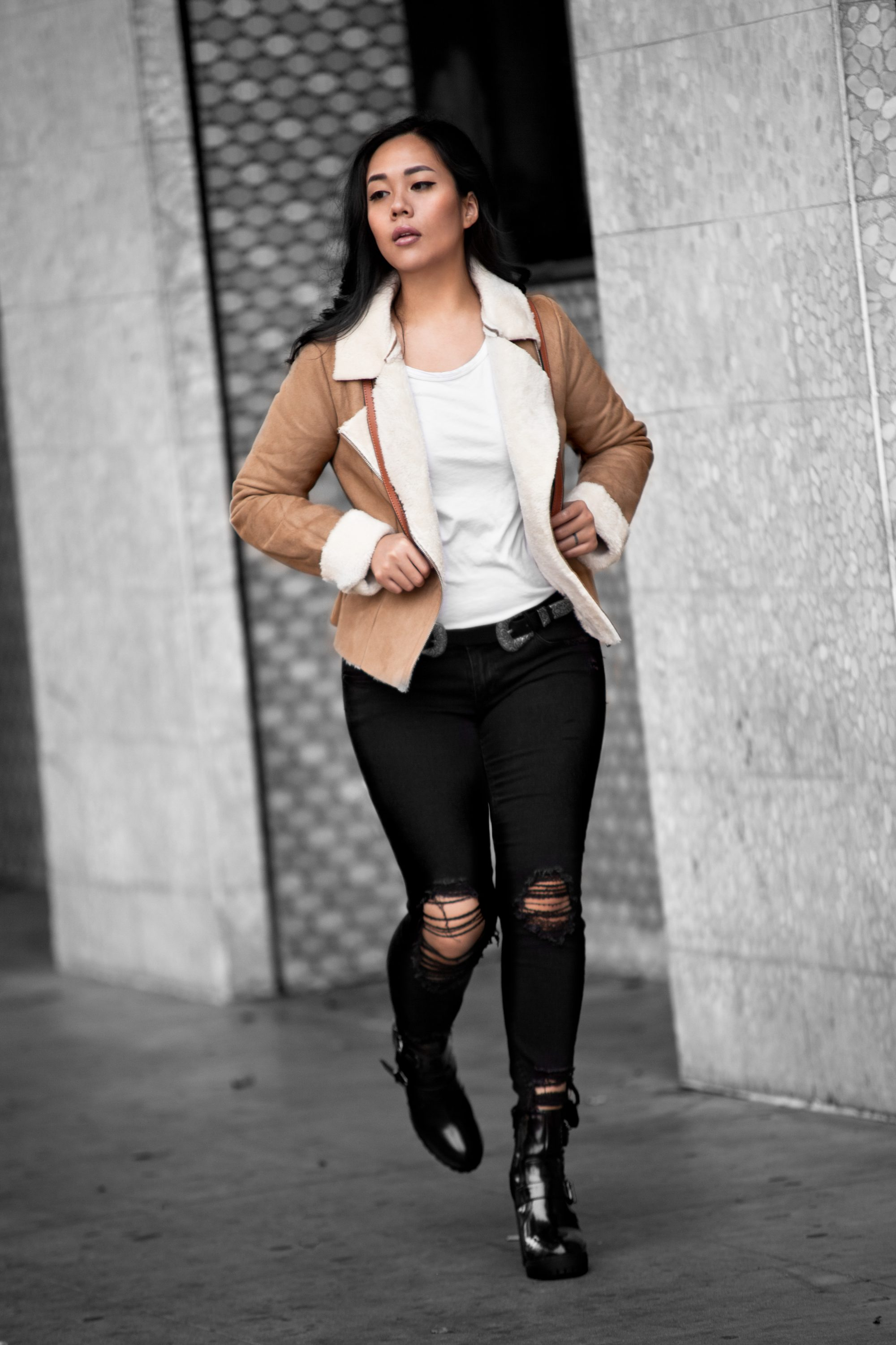 Shearling coats are so on-trend for winter. You can wear it fitted and pair it with high heels for a feminine look, or size up and wear it loose with flat moto boots for an effortlessly chic outfit. Get more styling tips at www.theballeronabudget.com