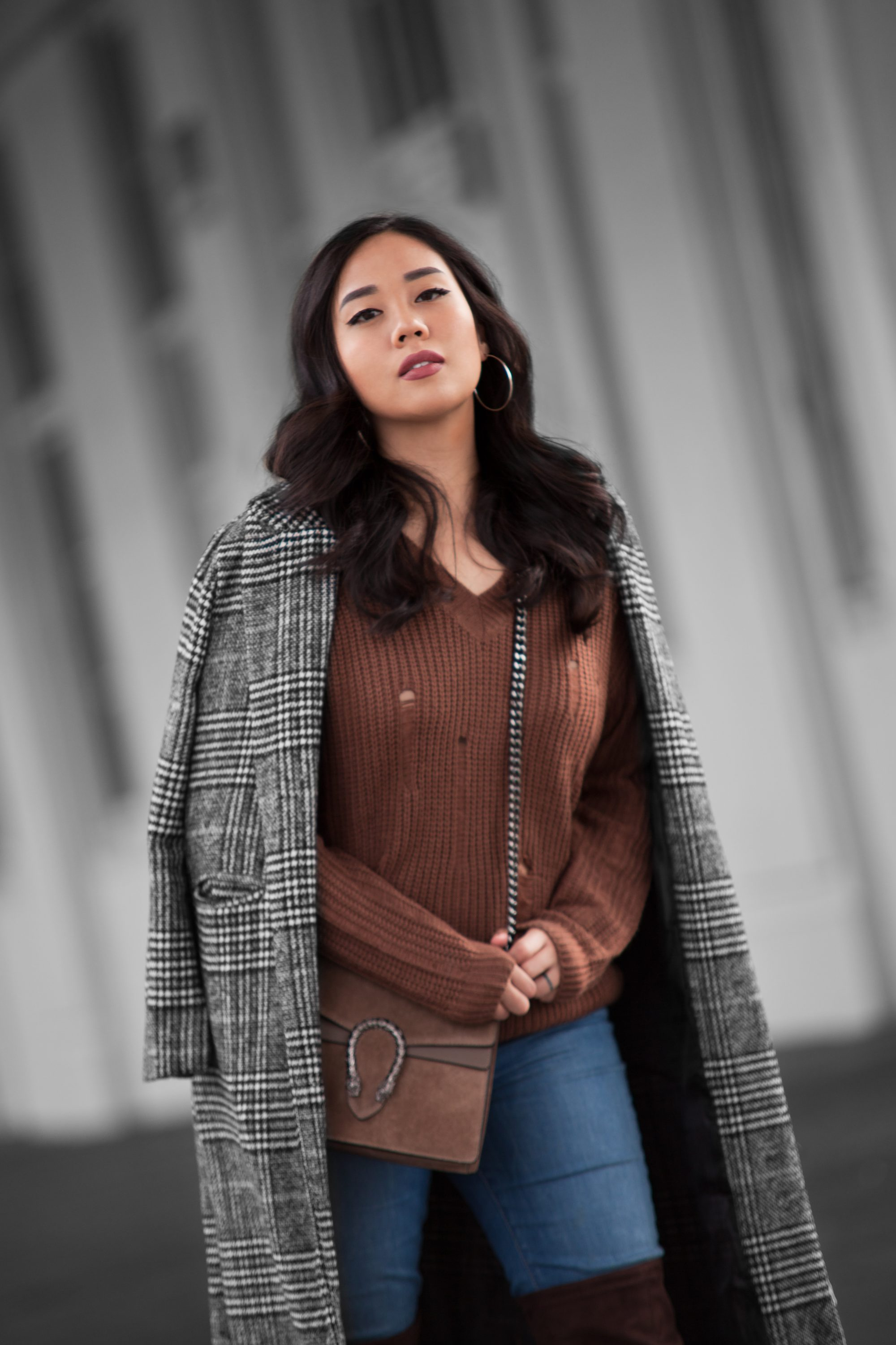 Brown is the perfect warm color for wintertime, which makes it perfect for sweaters. Get a knitted oversized sweater in a camel or teddy brown and you can pair it with a nice wash of blue jeans or distressed black denim and you're good to go.
