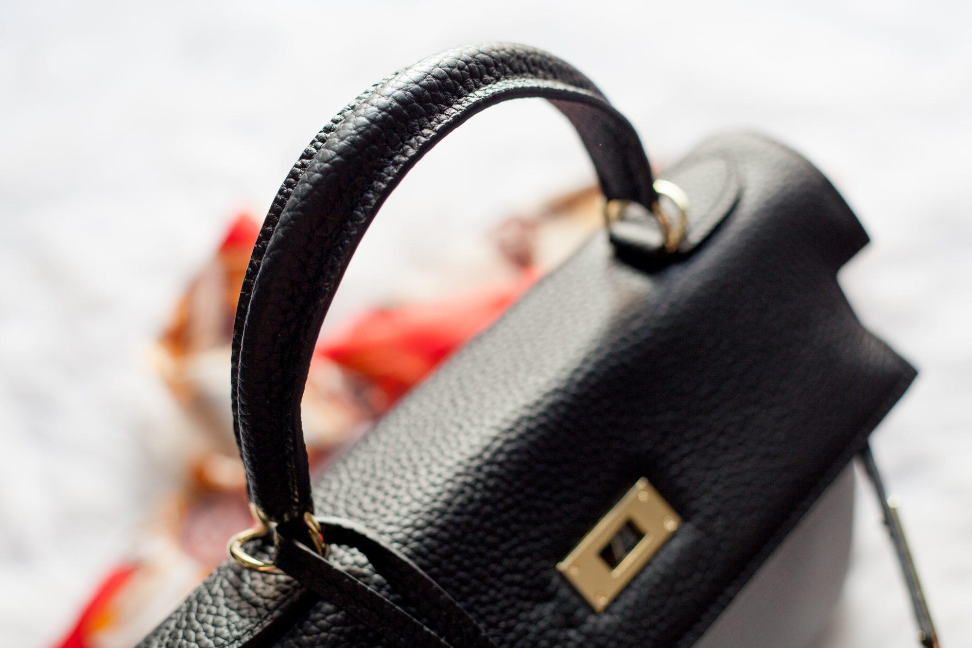 Looking for a dupe of the $8,600+ Hermes Kelly Bag without the expensive price tag? This designer dupe is made from genuine leather and is only $105! Check out the review with lots of detailed photos. - www.theballeronabudget