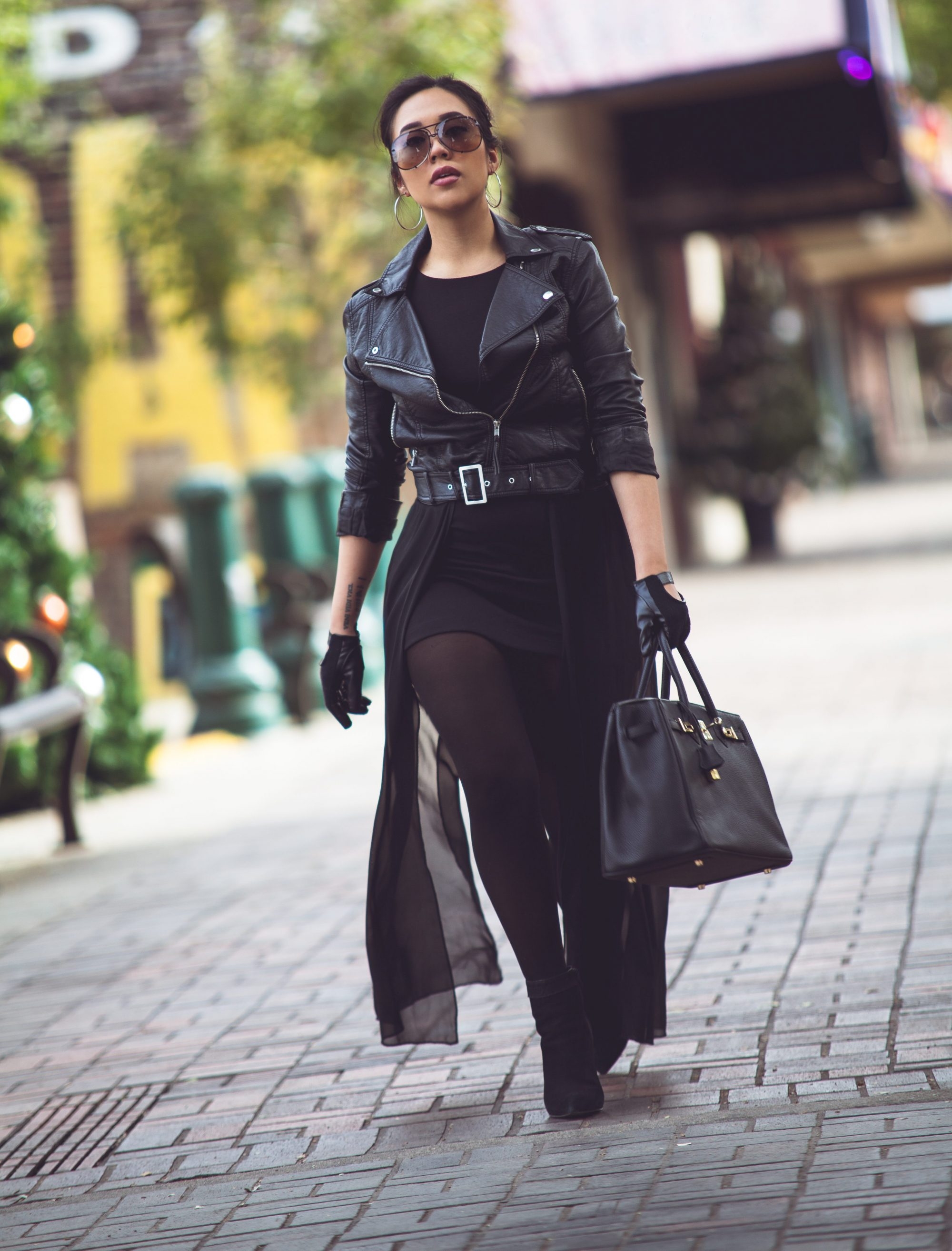 "Not sure where to start? You can't go wrong with all-black. It's sleek, chic, and gives off a total ""don't mess with me"" vibe. To avoid looking goth and appear more fashion-forward, play with textures - grab a biker jacket, wear pleather jeggings, or wear distressed jeans. - www.theballeronabudget.com"