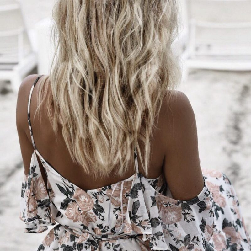 Showing your shoulders off, whether it's with an off-the-shoulder or one-shoulder cut can help place the focus on your decollete area, which is perfect if you want a slightly sensual vibe without a plunging neckline. Dayna from daynawithoutrules.com killed this look! - www.theballeronabudget.com