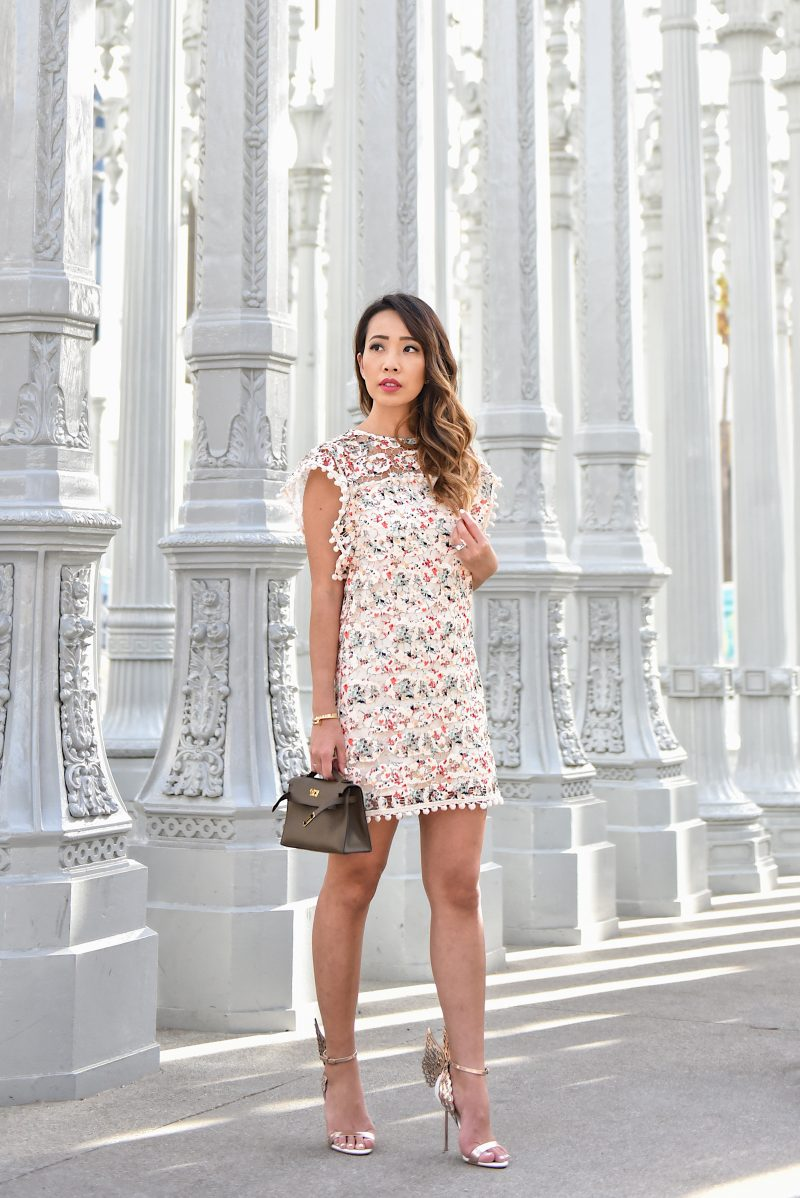 Lacey layers and ruffled edges are perfect for staying trend-forward but with a more innocent vibe: maybe this is your first date with this guy, or you might be going out with your girls. Either way, Wynn of Wander x Luxe is definitely chic with her frills and ruffled dresses. - www.theballeronabudget.com