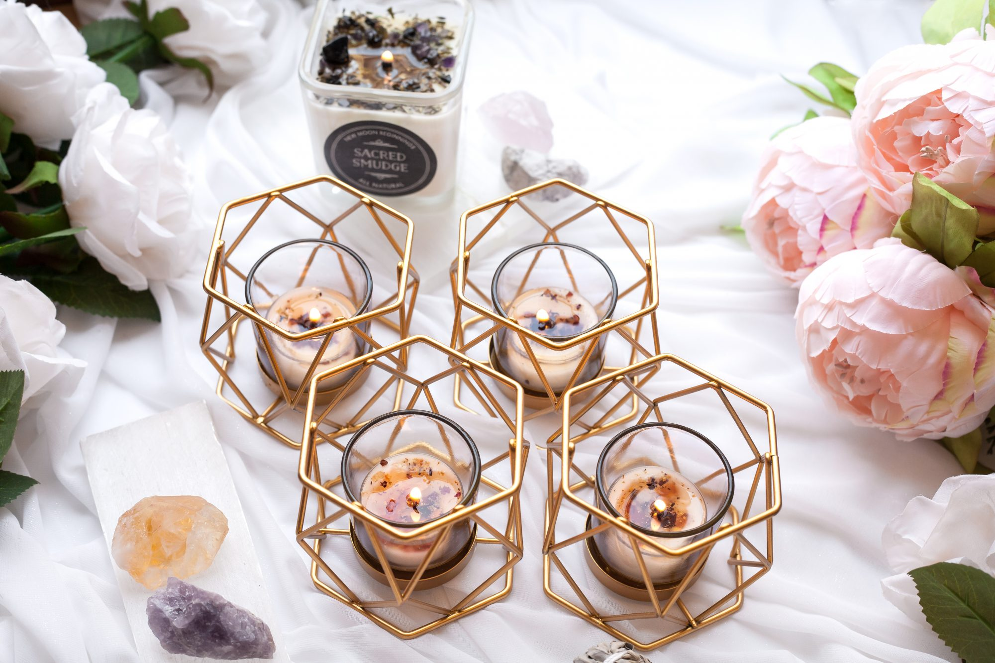 Crystal and herb-infused candles are a great way to use the energy of crystals in a decorative way. These candles from New Moon Beginnings are infused with crystals and herbs and are made with soy wax and essential oils. - www.theballeronabudget.com