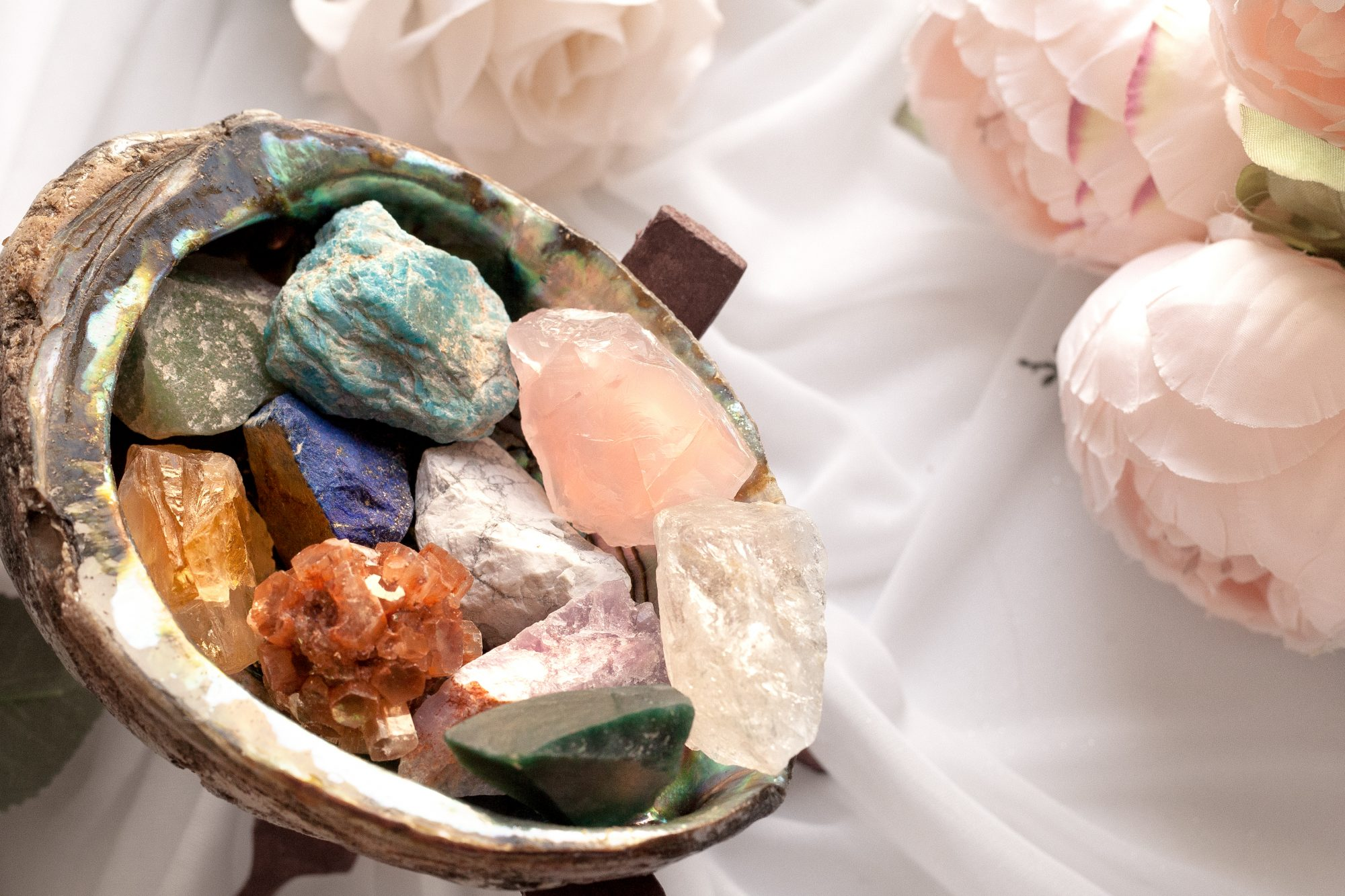 Keep crystals in around the house to raise the vibrational energy at home. Place them in decorative dishes near the entryway or on your desk. - www.theballeronabudget.com