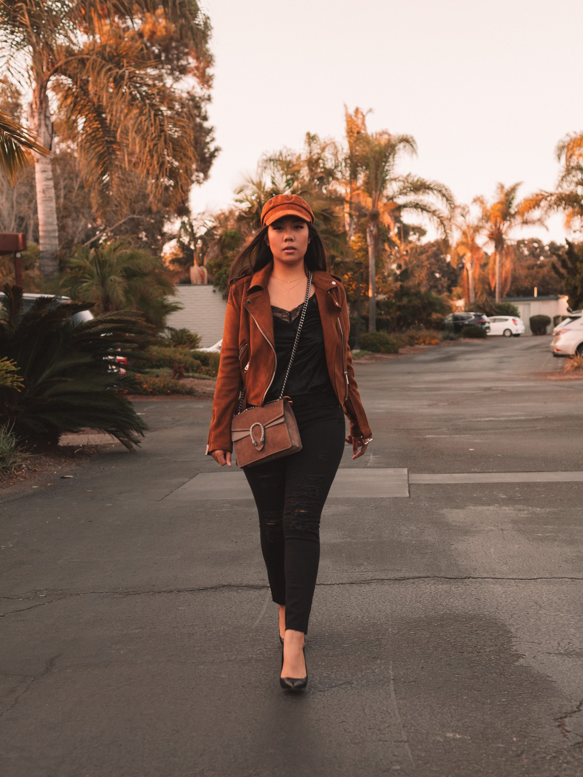 Although regular leather is more durable, you can always try a suede jacket to switch up the texture of the jacket. Suede offers a nice muted tone to colored jackets, so it's a great finish to try a new color if you prefer a more subtle look. - www.theballeronabudget.com