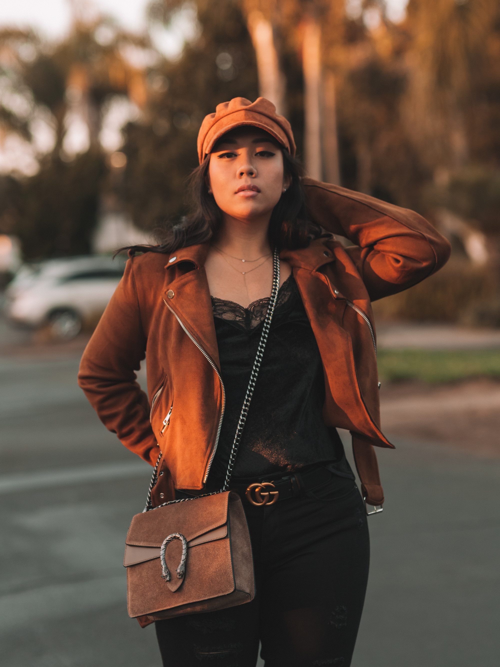 I'm sure you probably have your very own black moto jacket in your closet right now (if you don't, you can always grab a quality leather or faux leather one at Shopbop!), so let's talk about ways to spice up the iconic jacket. - www.theballeronabudget.com