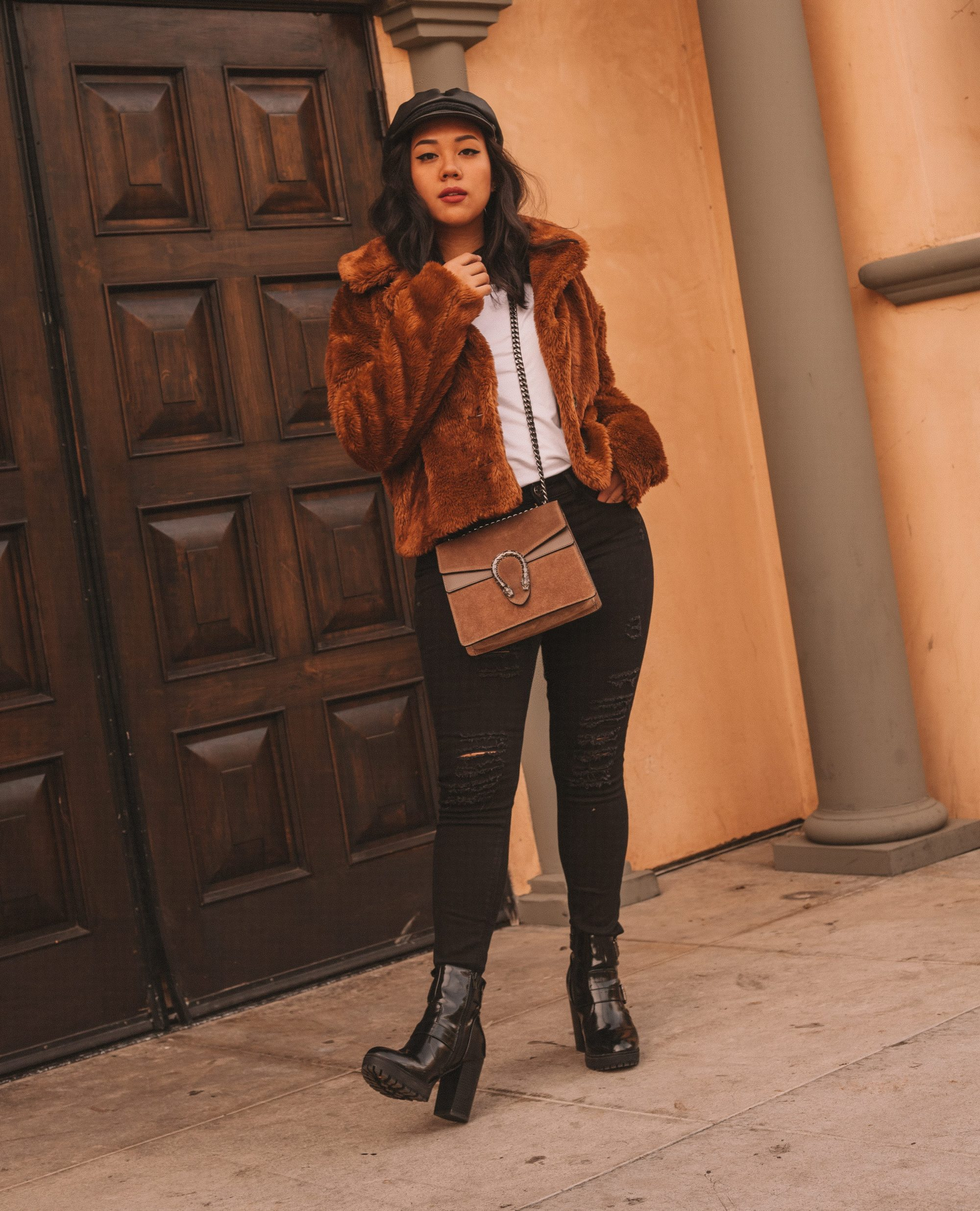 755adafe3 Free People Mena Faux Fur Coat: $128 $96 | Brixton Fiddler Faux Leather  Cap: $44 | Gucci Dionysus Handbag Dupe: $119 | SODA Platform Chunky Boot:  $24.99