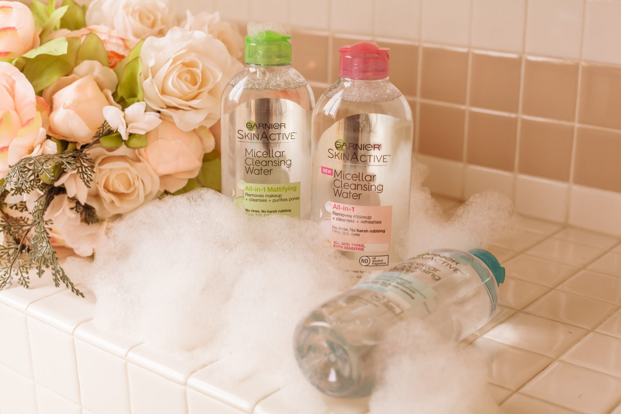 """Garnier's SkinActive Micellar Cleansing Water is an all-in-1 cleansing water that removes makeup, cleanses, and refreshes your skin. It's not an oil-based cleanser, although the formula consists of tiny """"micelles"""" - tiny balls of cleansing oil molecules- that are suspended in soft water, so you get the effectiveness of a cleansing oil with the consistency of water. It's perfect for people like me whose skin is extremely reactive to oil-based cleansers, so we can still have our cake and eat it too! - www.theballeronabudget.com"""