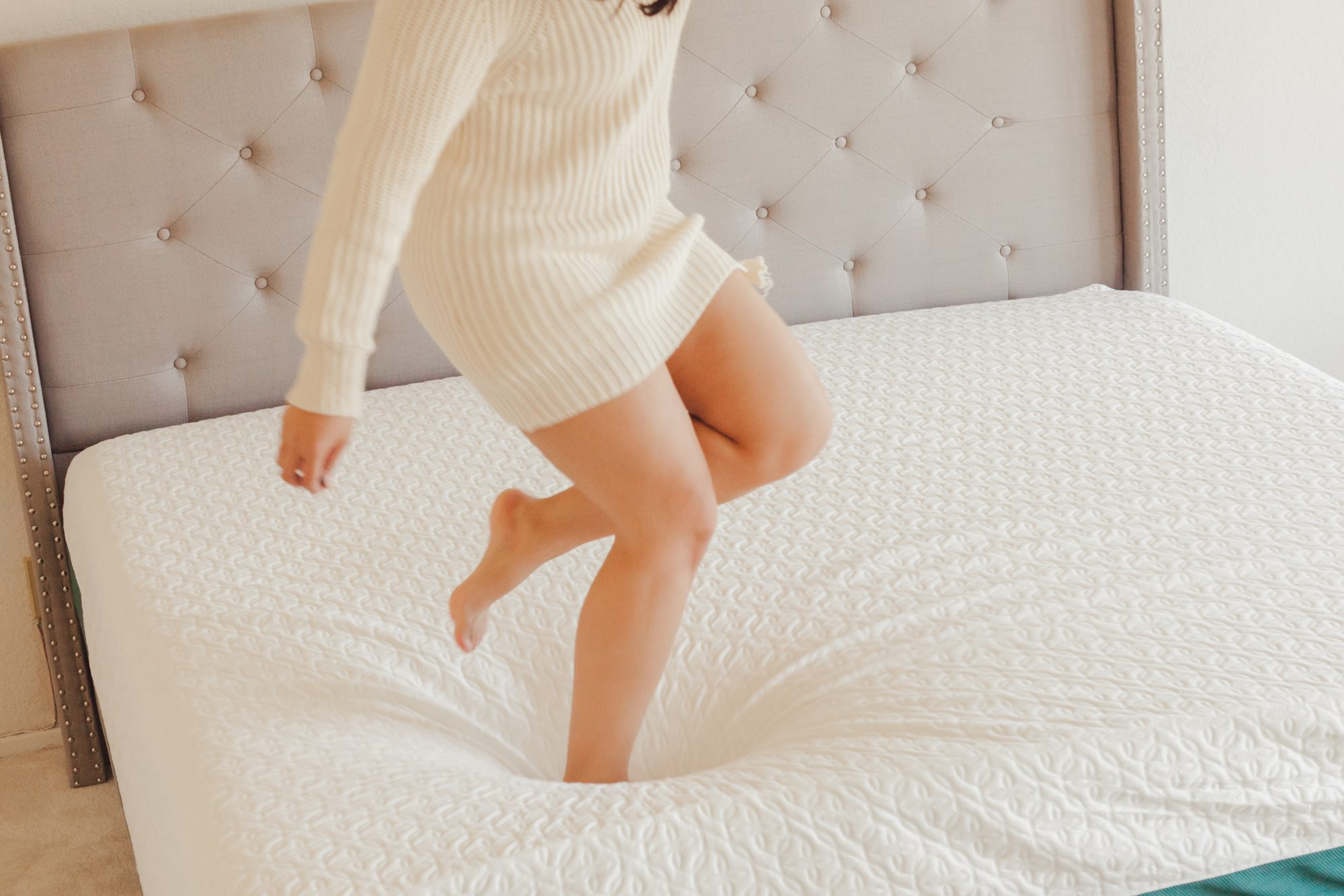Tip: if the corners are still curled after 48 hours, try jumping on the mattress to allow the foam to spring up. - www.theballeronabudget.com