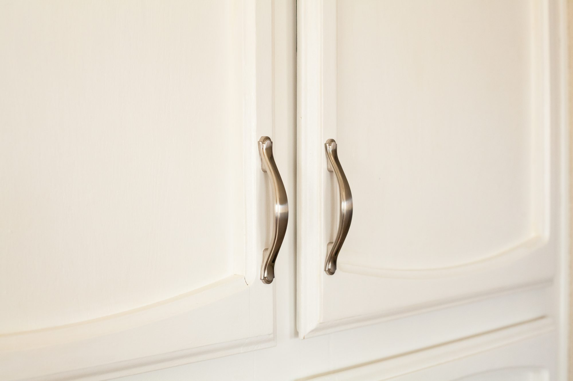 AmazonBasics Traditional Craftsman Cabinet Handles installed on newly painted cabinet doors