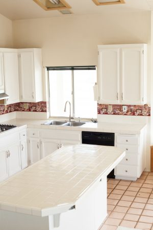 After image of kitchen cabinets painted with white milk paint