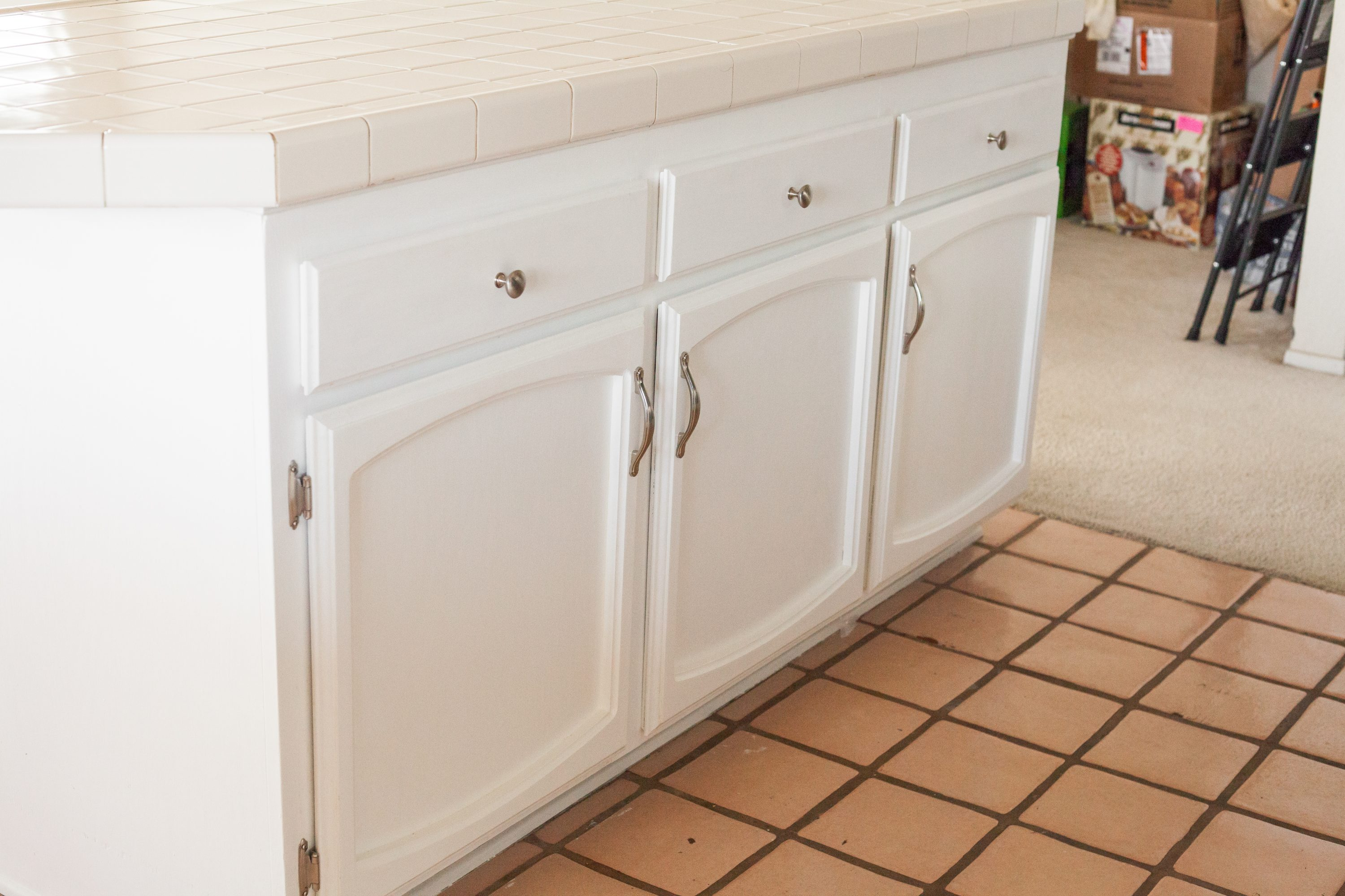 After image of kitchen island cabinets painted with white milk paint