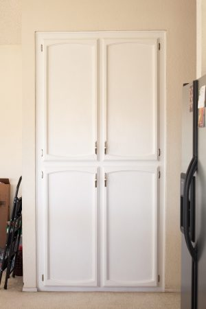 After image of kitchen pantry cabinets painted with white milk paint