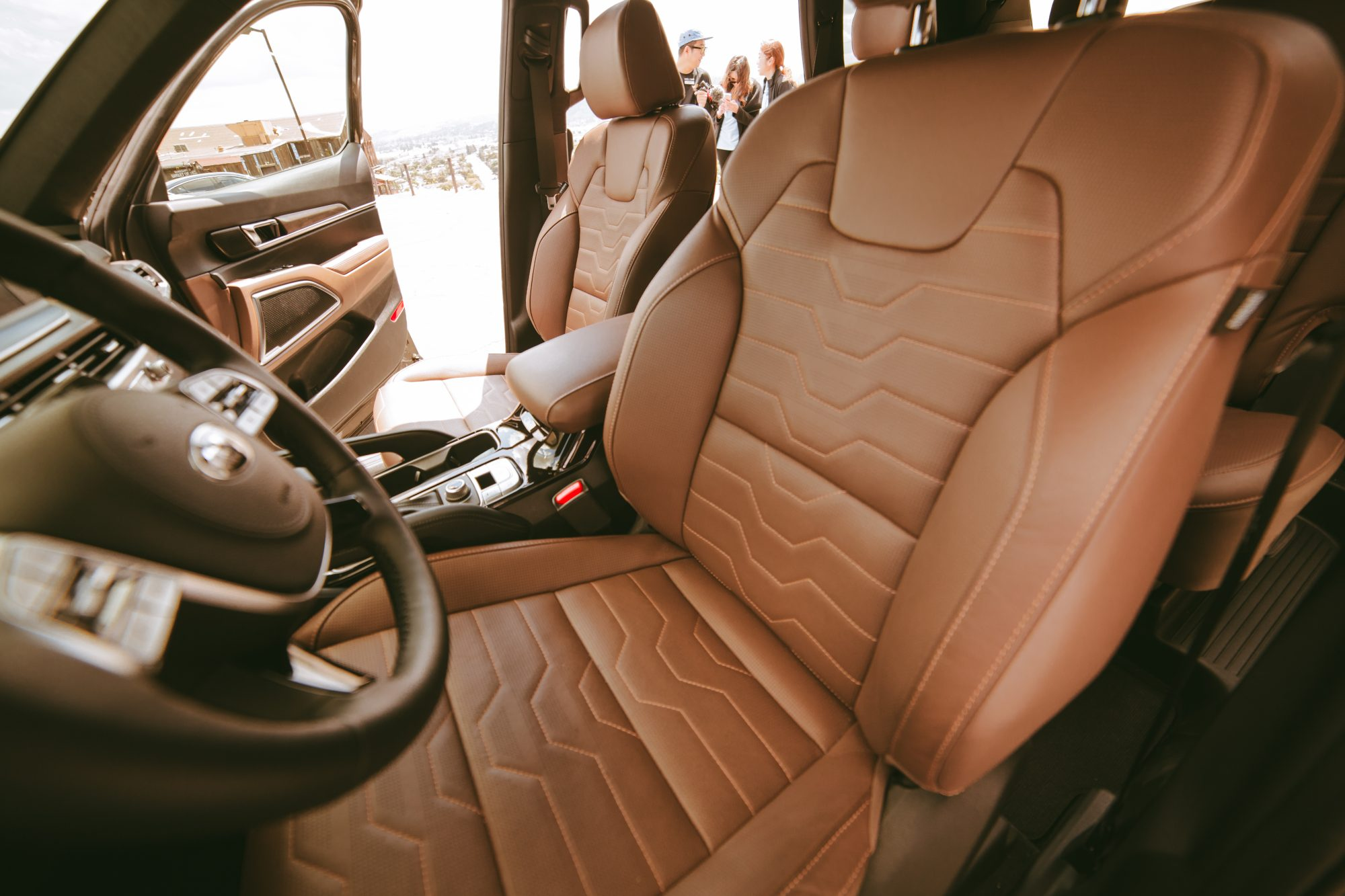 Kia also made the decision to ditch a cloth interior and give the LX and S trims SOFINO leatherette, which looks and feels like leather, is just as durable, and is an equally luxurious option as the Nappa leather in the EX and SX. - www.theballeronabudget.com