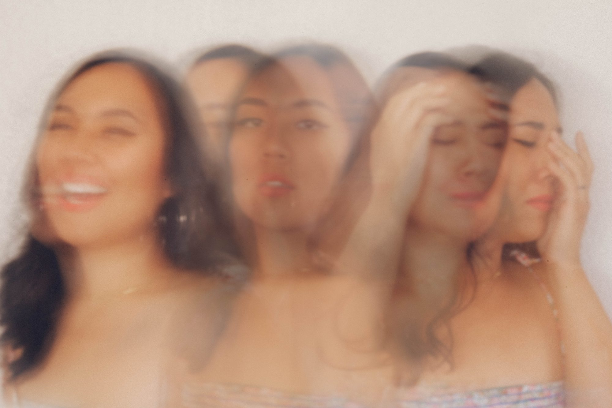 Long exposure photo of woman experiencing emotions from happy to sad