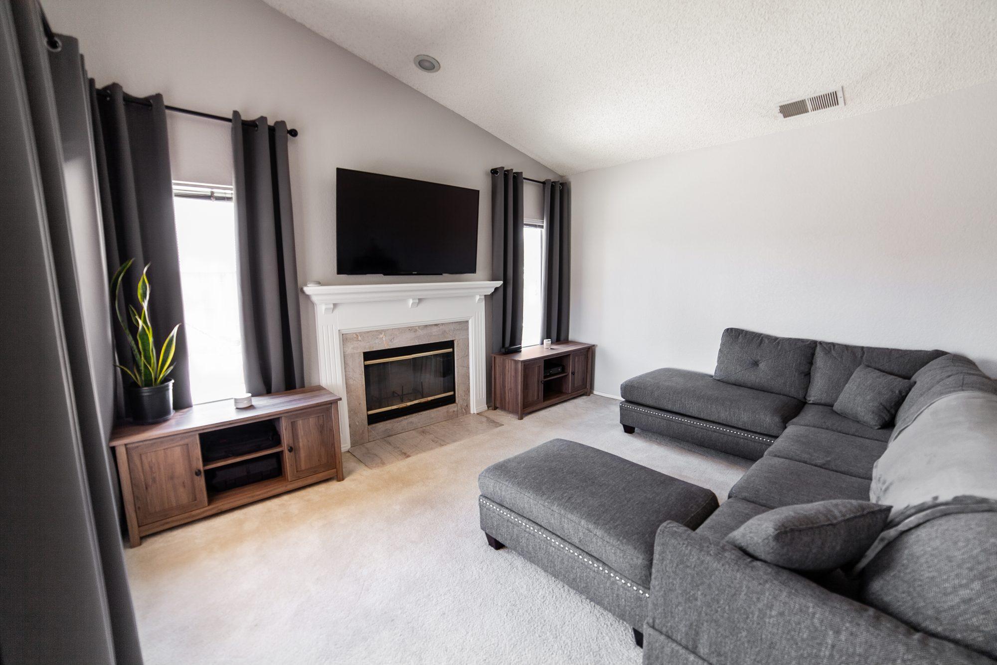 Neutral gray family room renovation