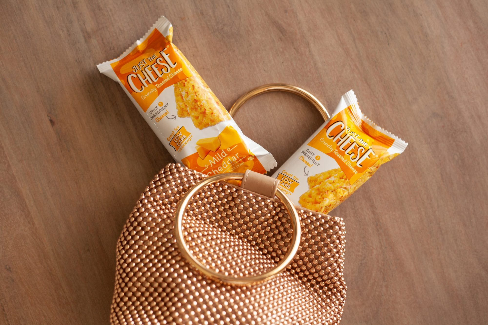 Zero carb cheese bars in a handbag for on-the-go low-carb snacking