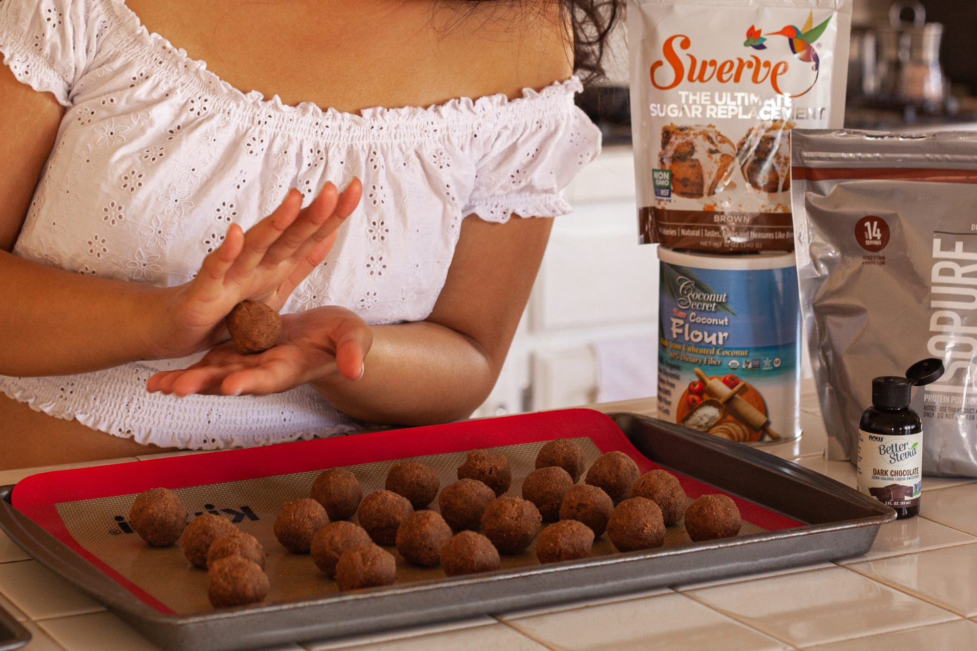 Close-up of hands making protein ball snacks using protein powder