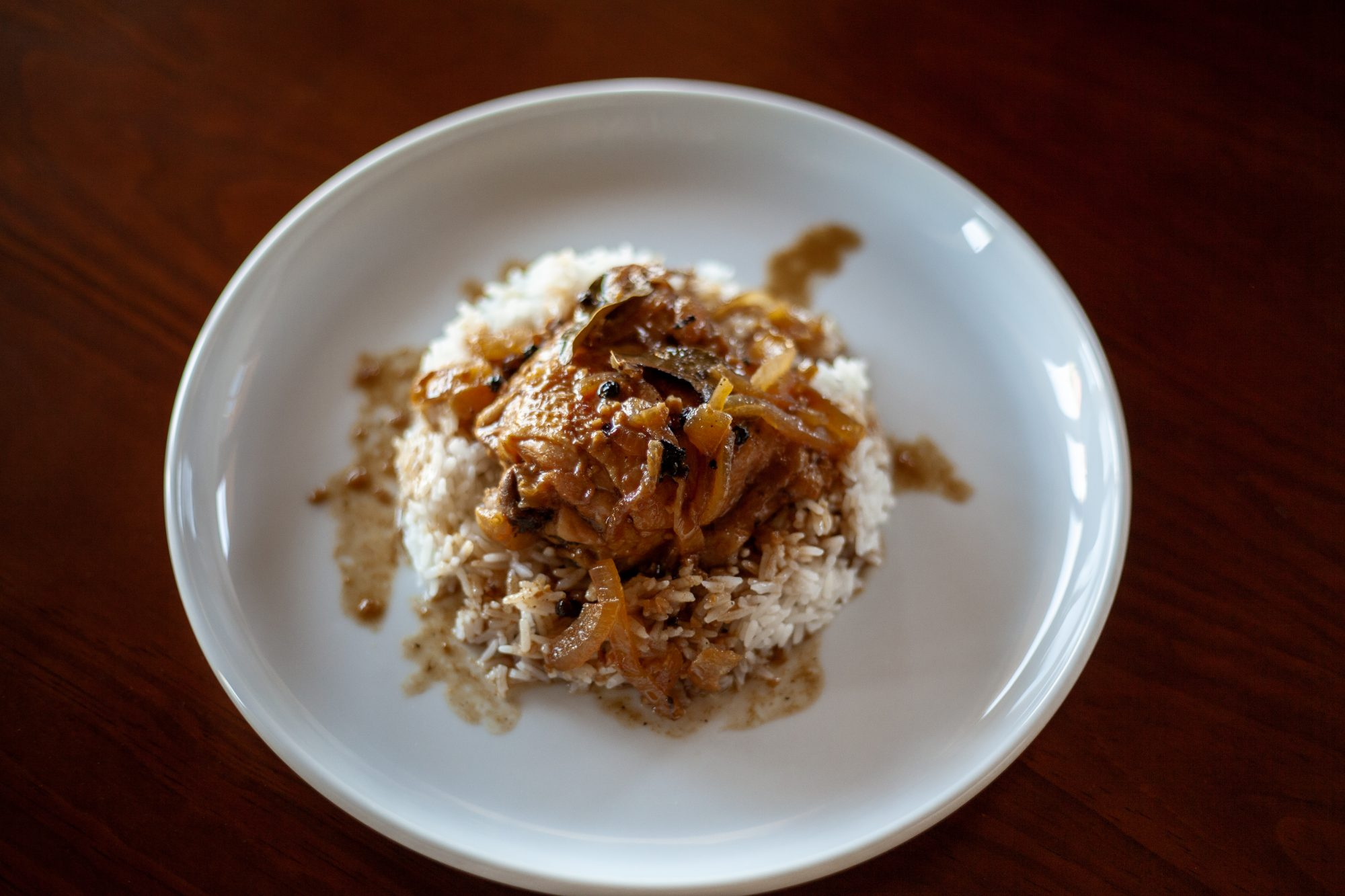 Filipino Chicken Adobo meal with rice on a plate